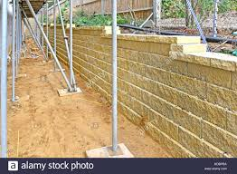 Concrete Block Garden Wall by Dry Construction Using Hollow Concrete Blocks Filled With Gravel