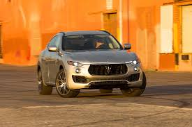 orange maserati 2017 maserati levante sq4 first test review motor trend