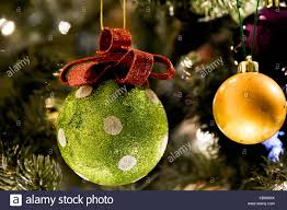 green and white polka dot and gold baubles hanging on a