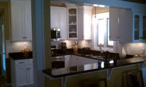 black granite countertop also yellow wall paint decoration with black granite countertop also yellow wall paint decoration with white cabinetry abd darwers lockers storage pain free shaped kitchen