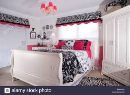 bedroom in american house in white pink and black colors