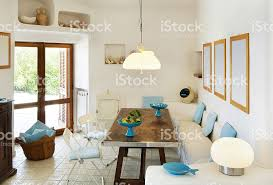 livingroom in white livingroom in beautiful seaside house with glass door