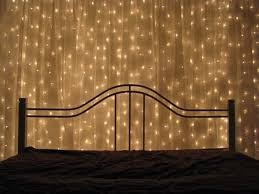 you can hang strings of lights up on the wall your bed and