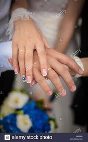 beautiful hand rings images Beautiful hands of wedding couple wedding rings and flowers stock jpg