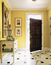 yellow wall paint color with wooden door and foyer foyer paint