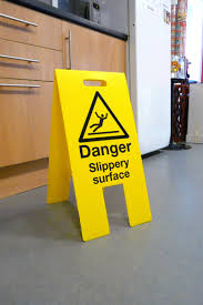 Wet Kitchen Cabinet Flooring Ideas Wet Floor Signs Law In Front Of Wooden Kitchen