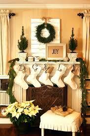 christmas decorating around fireplace mantel photos door bright