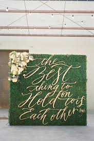 wedding backdrop quotes gold script the best thing to hold on to is each other quote on