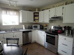 Small Kitchen With White Cabinets Marvelous L Shaped White Cabinets With Black Rounded Breakfast