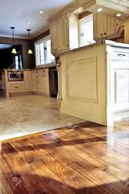 Kitchen Floor Idea Hardwood And Tile Floor In Residential Home Kitchen And Dining