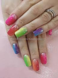 multicoloured gel polish with fades and glitter nails and