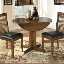 Round Pedestal Dining Table With Extension Leaf Abbott Place Round Drop Leaf Pedestal Dining Table With Butterfly