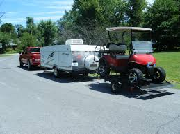 Chevy Silverado Truck Bed Extender - hauling golf cart pulling camper with tailgate down anyone done
