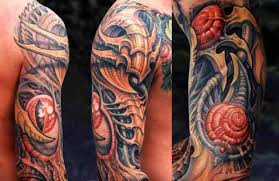 great biomechanical tattoo by guy aitchison design of