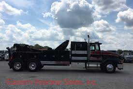 1991 international 9400 sleeper with a century 5030 30 ton heavy