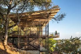 modern lake house retreat built cliffside in