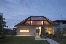 Hip Roof House Plans Gallery Of House With A Large Hipped Roof Naoi Architecture