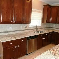 Brown Tile Backsplash by Kitchen Beautiful Granite Countertop On Wooden Wardrobe