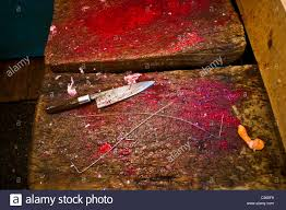 butcher stock photos butcher stock images alamy a bloody butcher block with a knife stock image