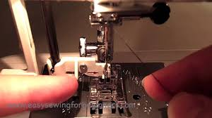 how to use the automatic needle threader on a sewing machine youtube
