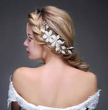 ascent your bridal hair style with white jewelry weddceremony