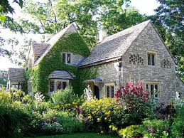 The English Cottage | english cottage with ivy bird niches and surrounded by an english