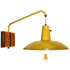 scandinavian teak wall mount lamp with brass and fiberglass