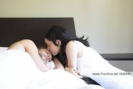 Man Sleeping In Bed Young Woman Kissing Man Sleeping In Bed Royalty Free Image