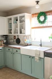 different color upper and lower kitchen cabinets will white
