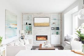 Contemporary Living Room Features A Fireplace Wall Fitted With - Contemporary fitted living room furniture