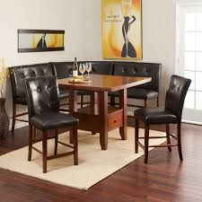 dining table with rug underneath breakfast nook showing black leather bench and brown counter height