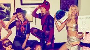 taylor swift rocks deadpool costume from ryan reynolds for