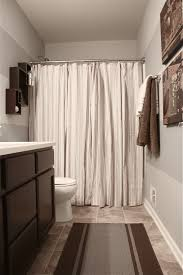 bathroom shower curtains ideas the yellow cape cod boy s bathroom reveal using two shower curtains