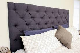 upgrade your master bedroom with a diy tufted headboard southern