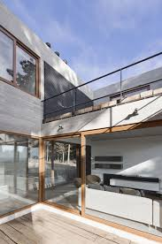 interesting balcony design of coppin penthouse with windows which