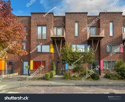 colorful modern suburban family rowhouses lively stock photo