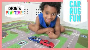 cute kid playing on car racetrack rug blaze u0026 the monster