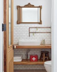 wood timber vanity design in half bath showing exposed piping