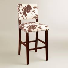 have a cow print chair for interior with sweet milky nuance