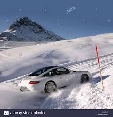 porsche snow porsche 911 targa 4s model year 2006 white driving diagonal