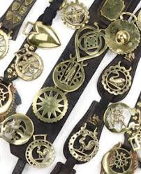 buy three collectible vintage brasses on black leather