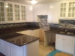 white cabinetry with lockers and panel appliances also grey