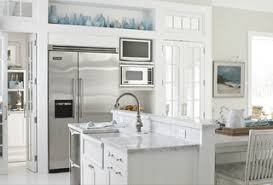 gorgeous white kitchen cabinets with wooden chairs and layout