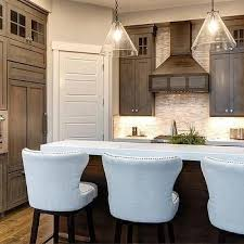 brown stained kitchen cabinets with white quartz countertop home