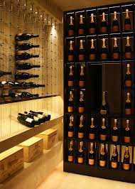 travertine wine and champagne cellar featuring the cable wine