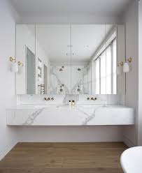 Floating Bathroom Sink by Modern Bathroom Features A Floating Marble Vanity Fitted With His