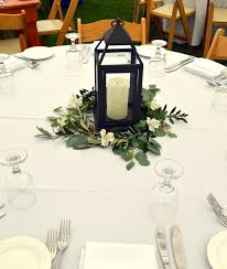 Lanterns With Flowers Centerpieces by Vintage Lantern Wedding Centerpiece Surrounded By White
