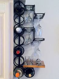 wall mounted metal wine racks with small wood shelves and glass