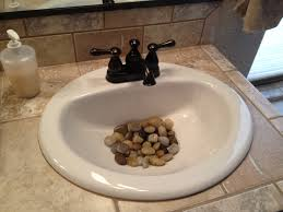 river rocks in the bathroom sink a little feng shui but a neat