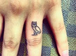 if small tattoos are more your thing this tiny ovo owl symbol is